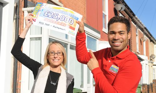 Portsmouth winner Paula celebrating with Street Prize Presenter Danyl Johnson