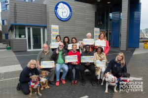 Our lucky Postcode Millions winners, celebrating outside Battersea Dogs & Cats Home