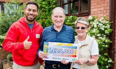 Danyl Johnson with £25,000 winners Barry and Lynette