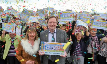 East Devon resident George Sloan and his fellow players celebrate their £3 Million win in February's Postcode Millions