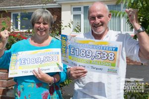 Big winner Ian and his wife looking pleased with their two cheques