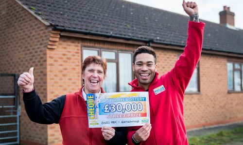 Lilian looking ecstatic with her £30,000 cheque and Street Prize Presenter Danyl Johnson