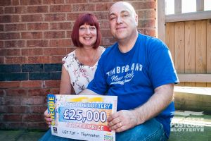 Ian and Paula with their whopping £25,000 cheque