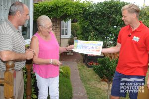 Sheila and Colin being surprised with their brilliant £25,000 cheque