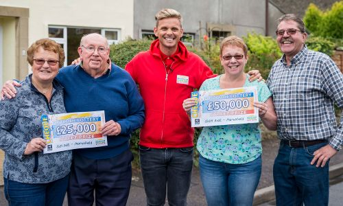 Street Prize Presenter Jeff Brazier with the lucky Marshfield winners