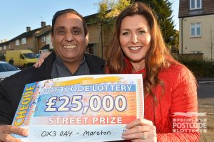 02. Judie and Mohammed cheer on his good fortune