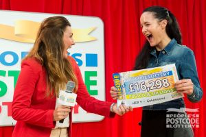 Judie passes over a whopping cheque to one lucky winner