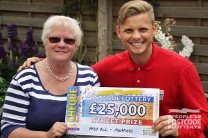 Ambassador Jeff with winner Diane and her cheque for £25,000