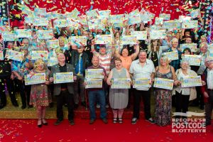 Our Gateshead Postcode Millions winners with their amazing cheques