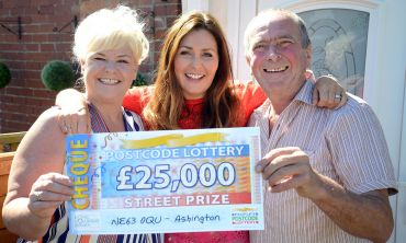 Judie with lucky winner Dawn and her partner Peter and their whopping £25,000 cheque