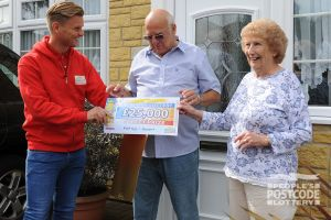 Maureen and Rodger receiving their £25,000 cheque