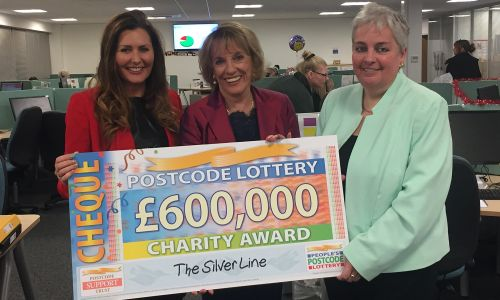 The Silver Line founder Dame Esther Rantzen receiving the £600,000 award from People's Postcode Lottery Ambassador Judie McCourt