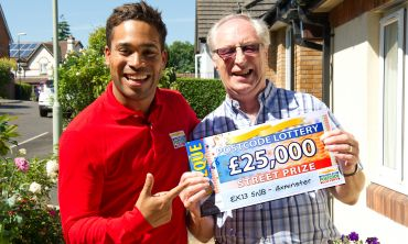 Lucky Axminster winner Edward with Street Prize Presenter Danyl Johnson