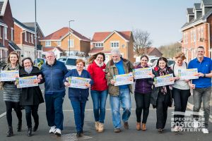 Seven of the happy Hartlepool winners and their fabulous £30,000 cheques