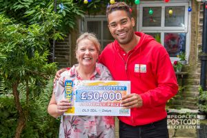 Denise and People's Postcode Lottery Ambassador Danyl Johnson