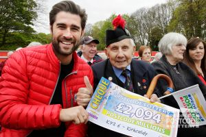 02. Matt hands over a cheque to 104-year-old winner Jimmy Sinclair