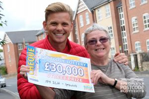Street Prize Presenter Jeff with winner Margaret and her wonderful £30,000 cheque