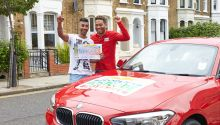 Lucky winner Jaspal celebrating with People's Postcode Lottery Ambassador Danyl Johnson
