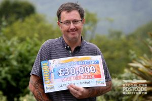 Happy Philip with his £30,000 cheque