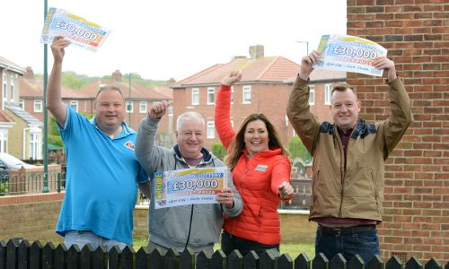 Three of the South Shields winners with their £30,000 cheques