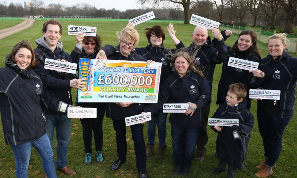 Members of The Royal Parks' team happily accepts a cheque for £600,000