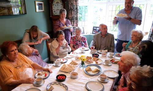 Guests gather at a Contact the Elderly Sunday afternoon tea party
