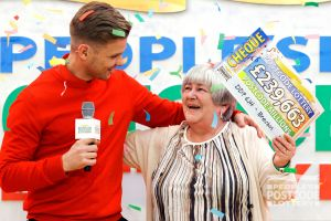 Jeff delivering a £239,663 cheque to big winner Sheila