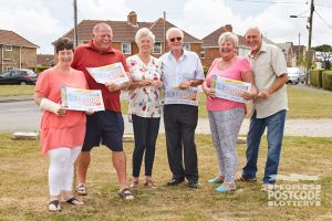 The Elvington winners and their £30,000 cheques