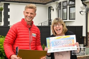 Lisa's first big surprise was Jeff handing over her cheque for £50,000