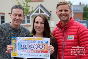 Gemma and Matt collecting a fantastic prize win from Street Prize presenter Jeff Brazier