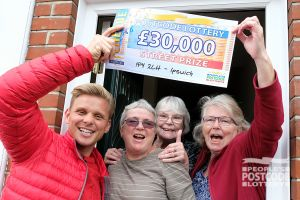 Jeff and the Ipswich sisters celebrating a £30,000 win