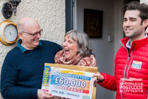 Matt surprising Andrew and Anne with a staggering £60,000 cheque
