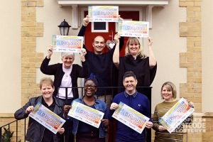 Seven happy Tidworth winners with their fabulous cheques