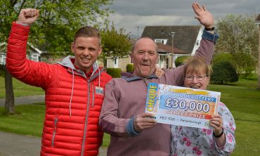 Winner Julie and her husband Paul were surprised to receive a £30,000 cheque from Street Prize Presenter Jeff Brazier