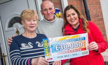 Lucky winner Joan with her partner Robert and her fabulous £30,000 cheque