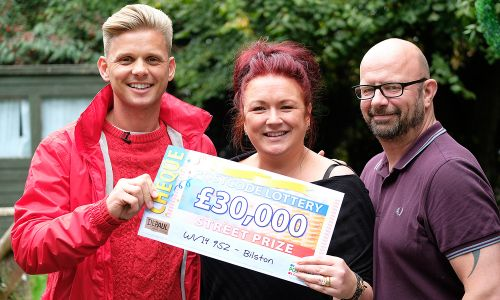Happy Bilston winner Susan with her husband Mark and Street Prize Presenter Jeff Brazier