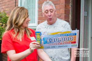 Judie surprising Martin on his doorstep with a big cash prize