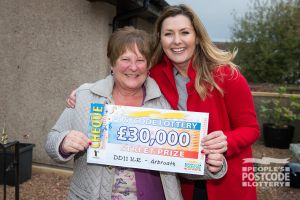 Anna was delighted to receive her £30,000 cheque from Judie McCourt