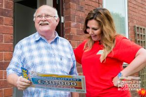 It was smiles all round when Judie handed over Brian's £30,000 prize