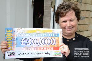 Winner David Gillespie's mum Lynn picked up his £30,000 cheque on his behalf