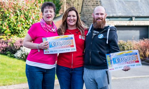 Pleased Sowerby Bridge winners Victoria and Richard with Street Prize Presenter Judie McCourt
