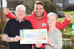 Danyl delivering a whopping £30,000 cheque to winner Jack and his wife, Sandra