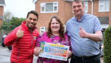 Street Prize Presenter Danyl Johnson with lucky winner Jane and her husband Garry