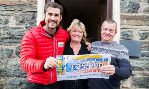 Lucky winner Eric with his wife Sue and People's Postcode Lottery Presenter Matt Johnson