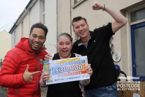 Julie couldn't believe her luck when Danyl Johnson presented her cheque for £30,000