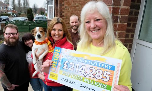 Postcode Millions winner Ann collecting her amazing cheque