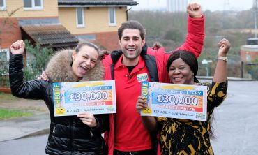 Two of the happy Walthamstow winners with Street Prize Presenter Matt Johnson