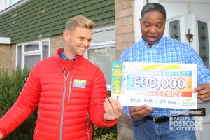 Kenneth was shocked to receive £90,000 after collecting a £30,000 cheque on behalf of his partner just minutes before!