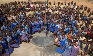Pupils of Mabhiza school around the repaired borehole