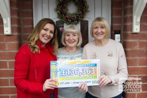 A lucky winner and her mother having been surprised by Judie McCourt